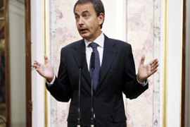 Spanish Prime Minister Jose Luis Rodriguez Zapatero talks to reporters about an earthquake in Lorca, at the Spanish parliament in Madrid May 12, 2011.