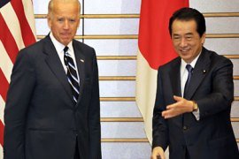 Tokyo, Tokyo, JAPAN : Visiting US Vice President Joe Biden (L) is greeted by Japanese Prime Minister Naoto