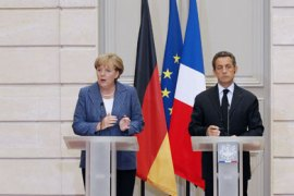 France's president Nicolas Sarkozy and German Chancellor Angela Merkel give a joint press conference at the Elysee presidential palace in Paris on August 16, 2011 after a meeting between the two leaders on debt crisis.