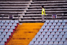 afp-A stewart walks on an empty tribune of the Udine's stadium in Udine