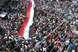 An image grab taken from a video uploaded on YouTube shows Syrian anti-government demonstrators marching in the coastal city of Latakia on August 12, 2011 as thousands of anti-regime protesters rallied in flashpoint cities after the Ramadan weekly prayers.