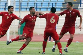 f_Lebanon's players celebrate after scoring a goal against the UAE during their 2014 World Cup Asia zone qualifying football match in Beirut on September 6, 2011.