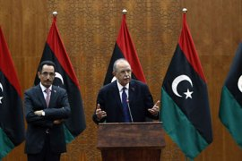 Libya's Prime Minister designate Abdurrahim El-Keib (R) and Abdul Hafez Goga, spokesman for the NTC attend a news conference in Tripoli November 22, 2011. Libya's National Transitional Council (NTC) on Tuesday named a new government featuring several surprise appointments that suggested the line-up was aimed at trying to soothe rivalries between regional factions. REUTERS/Mohammed Salem (LIBYA – Tags: POLITICS)