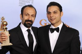 epa03061625 Iranian director Asghar Farhadi (L) and actor Peyman Moaadi (R) pose with the Golden Globe award for Best Foreign Language Film for 'A Separation' (Iran) in the Press Room at the 69th Golden Globe Awards held at the Beverly Hilton Hotel in Beverly Hills, Los Angeles, California, USA, 15 January 2012. EPA/PAUL BUCK