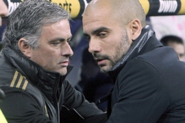 epa03066085 Real Madrid's Portuguese head coach Jose Mourinho (L) greets FC Barcelona's head coach Josep Guardiola (R) moments before their Spanish King's Cup quarterfinals first leg soccer match at Santiago Bernabeu stadium in Madrid, central Spain, on 18 January 2012.