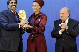 Emir of the State of Qatar Sheikh Hamad bin Khalifa Al-Thani (R) and his wife Sheikha Moza bint Nasser Al-Missned (C) receive the World Cup trophy from Fifa President Joseph Blatter after the official announcement that Qatar will host the 2022 World Cup on December 2, 2010 at the FIFA headquarters in Zurich.  AFP PHOTO / SEBASTIEN DERUNGS