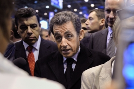 French President Nicolas Sarkozy (C) visits the Paris international agricultural fair at the Porte de Versailles exhibition center, on February 25, 2012 in Paris.