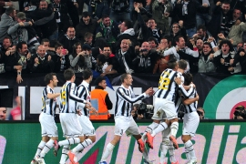 Juventus' Uruguayan defender Martin Caceres celebrates after scoring during the Italian Serie A football match between Juventus and Inter Milan at the Juventus Stadium in Turin on March 25, 2012.