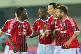 "AC Milan's midfielder of Ghana Sulley Ali Muntari (2nd L) celebrates after scoring during the Serie A football match between Chievo and AC Milan""Bentegodi"" Stadium in Verona on April 10, 2012. AFP PHOTO / GIUSEPPE CACACE"