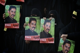 : (FILES) – A picture taken on Appril 24 2012 shows Bahraini Shiite Muslim women rally to show their solidarity with Abdul Hadi al-Khawaja (photos), a prisoner who is began his hunger strike, in the village of Jidhafs, West Manama