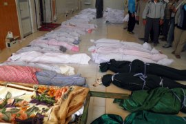 "handout image released by the Syrian opposition's Shaam News Network on May 26 , 2012, shows the bodies of killed people made ready for burial in the town of Houla. The head of a UN mission warned of ""civil war"" in Syria"
