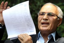 Egyptian presidential candidate Ahmed Shafik holds up documents during a press conference in Cairo, Egypt, 14 May 2012. Media reports state that Egypts parliament member Essam Sultan on 13 May lodged a complaint at the public prosecutor accusing Shafik, the former minister and prime minister during the rule of former president Hosni Mubarak, of selling pieces of land at low prices to Mubaraks two sons