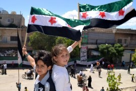 "A handout picture released by the Syrian opposition's Shaam News Network shows Syrian children waving pre-Baath Syrian flags during an anti-regime demonstration in Kfar Nubul in the northwestern province of Idlib on May 25, 2012. The opposition Syrian National Council has urged the UN Security Council to act urgently after claiming that regime forces ""massacred"" scores of civilians, including many children. AFP PHOTO"