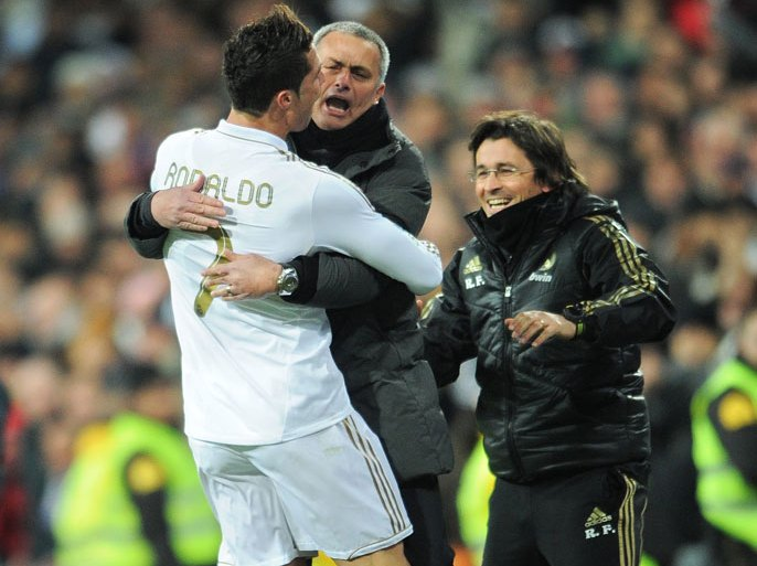 MADRID, SPAIN – FEBRUARY 12:  Cristiano Ronaldo (L) of Real Madrid celebrates scoring his sides second goial with head coach Jose Mourinho of Real Madrid during the la Liga match between Real Madrid and Levante at Estadio Santiago Bernabeu on February 12, 2012 in Madrid, Spain.  (Photo by Jasper Juinen/Getty Images)
