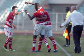 Tunisian Club Africain players congratulate their teammate Ndouasel Ezechiel (C) after he scored against Swaziland Royal Leopards FC during the CAF Confederation Cup football match at the Rades Olympic stadium near Tunis on May 12, 2012. Club Africain won 4-2. AFP PHOTO / FETHI BELAID