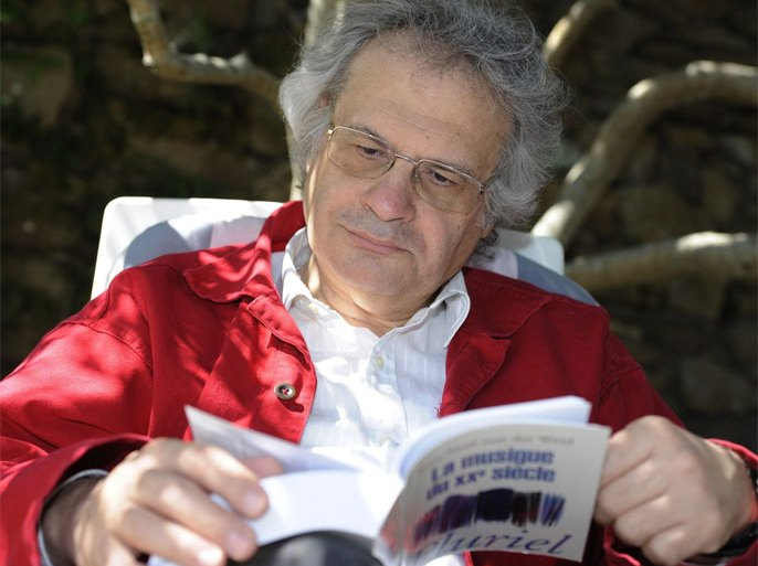 French-Lebanese writer Amin Maalouf looks at a book, on July 18, 2011, in the garden of his home at the Cadouere hamlet in Yeu island, western France. Maalouf, 62, whose books seek to build bridges between East and West, will succeed to French anthropologist Claude Levi-Strauss at the French Academy (official authority on the French language). Maalouf has published several novels that focus on the themes of Arab religious and national identity, in addition to journalism, essays and a work of history.