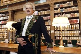 "French-Lebanese writer Amin Maalouf, a new member of the Academie Francaise (French Academy, part of the Institut de France) delivers a speech on June 14, 2012 at the Institut de France in Paris during a ceremony to mark his new membership in the institution. Maalouf, 63, dressed in the Academie Francaise's members' traditional green uniform, joined the ""immortals"", the term used to designate the 40 members of the Academie. Maalouf has published several novels that focus on the themes of Arab religious and national identity, in addition to journalism articles, essays and works of history. AFP PHOTO / FRANCOIS GUILLOT"