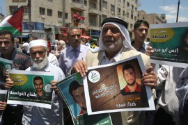 Palestinian supporters of the Islamic militant movement of Hamas, hold pictures of their relatives jailed in Palestinian authority prisons as they protest close to president Mahmud Abbas' headquarters, in the West Bank city of Ramallah, on July 4 2012. The protesters are demanding the release of their jailed relatives. AFP