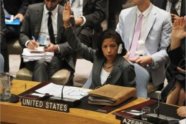 NEW YORK, NY – JULY 19: United States Ambassador to the United Nations Susan Rice (C) votes in favor of a new U.N. Security Council resolution on Syria at U.N. headquarters on July 19, 2012 in New York City. The resolution aimed at ending the violence with non-military sanctions in Syria failed to gather enough votes to pass as Russia and China veto the resolution.   Mario Tama/Getty Images/AFP== FOR NEWSPAPERS, INTERNET, TELCOS & TELEVISION USE ONLY ==