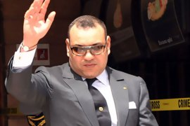 f_A picture taken on April 30, 2011 shows Morocco's King Mohammed VI waving as he visits the Argana cafe where a bomb killed 16 people on April 28 in Marrakesh. Some of Moroccan King Mohammed VI's political and religious powers
