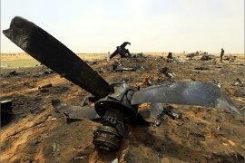 The remains of a Sudanese military plane is pictured after it crashed at the North Korodofan State border near the capital Khartoum October 8, 2012. The Antonov 12 transport plane, carrying personnel and equipment to the strife-torn Darfur region crashed near Khartoum on Sunday killing 15 people on board, the army said. REUTERS/Mohamed Nureldin Abdallah (SUDAN – Tags: TRANSPORT DISASTER MILITARY)