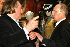 St Petersburg, -, RUSSIAN FEDERATION : A picture taken on December 11, 2010, shows Russia's President, then Prime Minister, Vladimir Putin (R) speaking with French actor Gerard Depardieu (L) as they tour Russky (Russian) Museum in St. Petersburg. Putin granted today fast-track citizenship to Depardieu after the movie star complained about the French Socialist government's proposed 75 percent tax on the rich.The decision appears to give Depardieu — a frequent guest of the Moscow celebrity circuit who nonetheless never asked for a Russian passport — the right to pay the 13 percent tax levied in Russia on everyone from billionaires to the poor. AFP PHOTO/ RIA-NOVOSTI POOL /ALEXEI NIKOLSKY