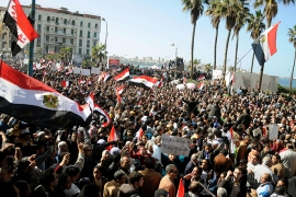 Egyptian demonstrator wave the national flag and shout slogans during a protest in Alexandria on January 25, 2013. Huge crowds are expected to demonstrate in Egypt on the second anniversary of the revolution that ousted Hosni Mubarak PHOTO/STR