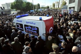 "People surround an ambulance transporting the body of Tunisian opposition leader and outspoken government critic Chokri Belaid, from from a clinic in Tunis to the public hospital for an autopsy, after he was shot dead with three bullets fired from close range, on February 6, 2013. Tunisian Premier Hamadi Jebali called the assassination ""an act of terrorism"", as the country grapples with growing political instability. AFP PHOTO / FETHI BELAID"