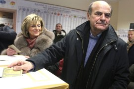 ITALY : Democratic Party's Pier Luigi Bersani, the favourite to become Italy's prime minister after the general election, casts his ballot in a polling station on February 24, 2013 in Piacenza. Italians fed up with austerity went to the polls on Sunday in elections where the centre-left is the favourite