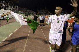 epa01850993 Algeria's Madjid Bouguerra (R) and Kamel Fathi Ghilas (L) celebrate after winning their FIFA World Cup South Africa 2010 African zone group C qualifying match against Zambia in Blida, some 50 km south of Algiers, Algeria, 06 September 2009. EPA/MOHAMED MESSARA