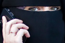 epa02929334 A woman wearing a niqab speaks on her phone outside the courthouse in Meaux, near Paris, France, 22 September 2011. The Meaux court, on 22 September, convicted two women for wearing Islamic veils in public – the first conviction since a ban on wearing the veils came into effect in April