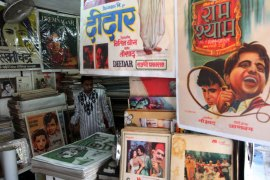 epa03605831 An Indian vendor sells old bollywood posters at the Chor Bazaar (Thieves Market), in Mumbai, India, 01 March 2013. Chor Bazaar is one of the largest flea markets in India, flanked by the rows of little antique shops and sell anything from old ship parts, old bollywood posters, authentic Victorian furniture, replacement parts for automobiles, old clocks, gramophones, to crystal chandeliers, at a very cheap price, although bargains are sometimes staggering