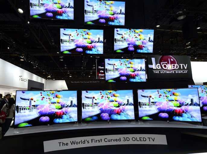 epa03528376 The world's first curved 3D OLED TV are displayed at the LG booth at the 2013 International Consumer Electronics Show in Las Vegas, Nevada, USA, 08 January 2013. The annual CES which takes place from 08-11 January is a place where industry manufacturers, advertisers and tech-minded consumers converge to get a taste of new gadgets and innovations coming to the market each year. EPA/MICHAEL NELSON