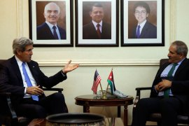 US Secretary of State John Kerry (L) meets with Jordan's Foreign Minister Nasser Judeh on May 22, 2013. Backers of the Syrian uprising are meeting in Amman to discuss a US-Russian proposal for peace talks, as the brutal two-year conflict escalates close to the border with Lebanon. Eleven top diplomats from Britain, Egypt, France, Germany, Italy, Jordan, Qatar, Saudi Arabia, Turkey, the United Arab Emirates and the United States are attending the meeting of the so-called Friends of Syria group. AFP PHOTO/JIM YOUNG/POOL