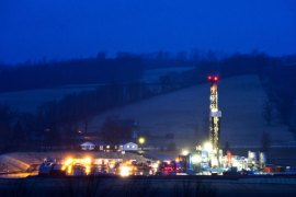 epa03163508 (01/20) A hydraulic fracturing drill rig lights up the landscape at dusk near Troy, Pennsylvania, USA, 08 March 2012. The controversial drilling practice, also known as fracking, requires injecting huge amounts of water, sand, and chemicals at high pressure thousands of feet beneath the earth's surface to extract reserves of natural gas. EPA/JIM LO SCALZO PLEASE SEE ADVISORY epa03163507 FOR FULL FEATURE TEXT