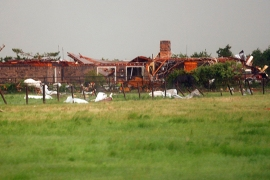 A home, damaged by a tornado, is seen south along Interstate-40 eastbound just east of El Reno, Oklahoma May 31, 2013. Violent thunderstorms spawned tornadoes that menaced Oklahoma City and its already hard-hit suburb of Moore on Friday, killing a mother and her baby, and officials worried that drivers stuck on freeways could be trapped in the path of dangerous twisters. One twister touched down on Interstate 40 and was headed toward Oklahoma City.  REUTERS/Bill Waugh (UNITED STATES – Tags: DISASTER ENVIRONMENT)