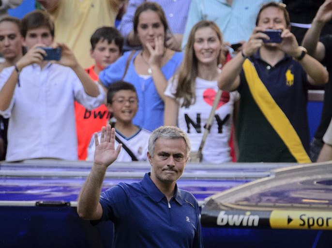 Real Madrid's coach Jose Mourinho waves after the Spanish League football match Real Madrid CF vs Osasuna at the Santiago Bernabeu stadium in Madrid on Jun 1 , 2013. AFP PHOTO / DANI POZO