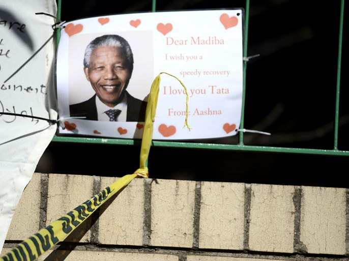 "SDS632 – Pretoria, -, SOUTH AFRICA : A photo taken on July 14, 2013 shows a wellwishing message for former South African President Nelson Mandela outside the Medi Clinic Heart Hospital in Pretoria. Graca Machel, the wife of Mandela, said she was less anxious about his condition on July 12, five weeks after he was admitted to hospital. After visiting Mandela late on July 11, President Jacob Zuma said he was ""responding to treatment."" Mandela was rushed to hospital on June 8 over a recurring lung infection. AFP PHOTO / STEPHANE DE SAKUTIN"