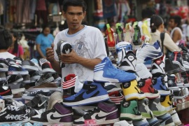 A man looks at sport shoes at a bargain center in Manila November 29, 2012. The Philippines' budget deficit narrowed to 9.67 billion pesos ($236 million) in October from the previous month as the government posted its second highest monthly revenue growth this year, allowing it to ramp up spending and boost economic activity.