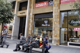 Members of the Internal security forces sit outside the Turkish Airlines offices in downtonw Beirut on August 12, 2013. Turkey has closed its cultural centre and commercial office in Beirut after the kidnap of two Turkish Airlines pilots, Ankara's ambassador to Lebanon told.