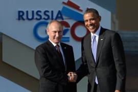 ST. PETERSBURG, RUSSIA – SEPTEMBER 05:  In this handout image provided by Host Photo Agency, Russian President Vladimir Putin (L) greets U.S. President Barack Obama at the G20 summit on September 5, 2013 in St. Petersburg, Russia. The G20 summit is expected to be dominated by the issue of military action in Syria while issues surrounding the global economy, including tax avoidance by multinationals, will also be discussed during the two-day summit.