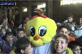 فرحة أطفال سوريا بالعيد بالحارات والأقبية خشية القصف
