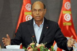 Tunisian President Moncef Marzouki speaks during a meeting as part of the dialogue between Tunisia's ruling Islamists and the opposition aimed at ending a two-month crisis on October 5, 2013 at the Palais des Congres in Tunis. Tunisia's ruling Islamist Ennahda party and the opposition signed a roadmap for the creation of a government of independents within three weeks. AFP PHOTO FETHI BELAID