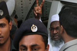 MUZ241 – Dhaka, -, BANGLADESH : (FILES) In this photograph taken on February 5, 2013, Abdul Quader Molla (R) the fourth-highest ranked leader of the Jamaat-e-Islami party, gestures at the central jail in Dhaka. Bangladesh's highest court held a hearing on December 10, 2013, to decide the fate of a leading Islamist leader sentenced to death for war crimes who was saved from the gallows by a dramatic last-gasp intervention. A judge stayed the hanging of Jamaat-e-Islami party leader Abdul Quader Molla just 90 minutes before his scheduled execution overnight at a jail in the capital Dhaka. AFP PHOTO/STR/FILES