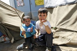 Palestinian children, displaced from the Al-Yarmouk Palestinian refugee camp south of Damascus