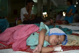 An Indian child suffering from Japanese Encephalitis lies on a bed at The Baba Raghav Das Medical College in Gorakhpur, some 250 kilometers (155 miles) southeast of Lucknow on June 11, 2012. The death toll due to the viral disease has risen to 88 in eastern Uttar Pradesh alone this year, according to the Press Trust of India. As many as 346 patients with symptoms of encephalitis have been admitted to the hospital so far this year, with most of the cases reported of water-borne encephalitis.