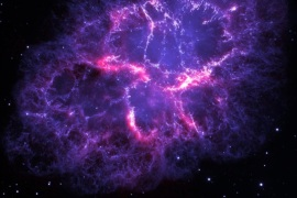 An undated handout photograph made available by ESA/Herschel/PACS/MESS Key Programme Supernova Remnant Team; NASA, ESA and Allison Loll/Jeff Hester (Arizona State University) on 14 December 2013 showing a composite view of the Crab nebula, an iconic supernova remnant in our Milky Way galaxy, as viewed by the Herschel Space Observatory and the Hubble Space Telescope. Herschel is a European Space Agency (ESA) mission with important NASA contributions, and Hubble is a NASA mission with important ESA contributions. A wispy and filamentary cloud of gas and dust, the Crab nebula is the remnant of a supernova explosion that was observed by Chinese astronomers in the year 1054. The image combines Hubble's view of the nebula at visible wavelengths, obtained using three different filters sensitive to the emission from oxygen and sulphur ions and is shown here in blue. Herschel's far-infrared image reveals the emission from dust in the nebula and is shown here in red. While studying the dust content of the Crab nebula with Herschel, a team of astronomers have detected emission lines from argon hydride, a molecular ion containing the noble gas argon. This is the first detection of a noble-gas based compound in space. The Herschel image is based on data taken with the Photoconductor Array Camera and Spectrometer (PACS) instrument at a wavelength of 70 microns; the Hubble image is based on archival data from the Wide Field and Planetary Camera 2 (WFPC2).