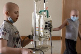 MINSK, BELARUS – MARCH 13: Pasha (left) from the city of Baranovichi and Vova (right) Kazakhstan walk down the hallway of the Children's Oncology Center on March 13, 2006 in Minsk, Belarus. Both children have been diagnoised with lymphoma. On April 26, 1986, reactor number four at the Chernobyl Nuclear Power Station on the border of the Ukraine and Belarus exploded. The fire, which burned out of control for five days, spewed more than 50 tons of radioactive fallout across Belarus. The wind carried the heaviest radioactive deposits across Belarus, where even today a large portion of the land is considered uninhabitable. The government denied the accident happened for several days, allowing the people in the Gomel region of Belarus to linger in the radiation. The cause of the medical illnesses are often hard to find, and much harder to prove. But, the rise in the number of cancer cases and other health problems in this region is too great for any other conclusion ? it has to be the radiation. (Photo by Ezra Shaw/Getty Images)