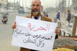 An Egyptian man holds a banner reading in Arabic 'freedom for (activists) Alaa Abdel-Fatah, Ahmad Abdel-Rahman and all detainees' in front of Tora prison, in Cairo, Egypt, 23 March 2014. An Egyptian court on 23 March 2014 freed Alaa Abdel-Fatah and co-defendant Ahmad Abdel-Rahman on a bail of 10,000 Egyptian pounds (around 1,428 dollars) each pending the resumption of the hearings on 06 April. Abdel-Fattah is standing trial along with 24 others for allegedly organizing an unauthorized protest in November 2013.