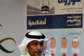 A Saudi man walks in front of a coronavirus poster prior to a press conference held by newly appointed Saudi acting Minister of Health Adel bin Mohamed Faqih on the Middle East Respiratory Syndrome (MERS) on April 29, 2014 in Riyadh. The health ministry reported more MERS cases in the city of Jeddah, prompting authorities to close the emergency department at the city's King Fahd Hospital. AFP PHOTO/FAYEZ NURELDINE